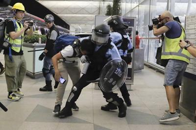 Riot police, protesters clash briefly at Hong Kong airport
