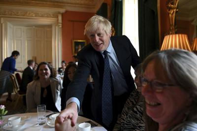 UK's Johnson weakened by party defections over Brexit