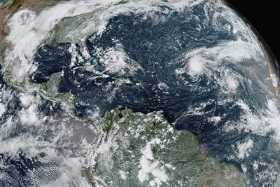 Depression strengthens into Tropical Storm Sally off Florida