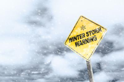 Winter,Storm,Season,With,Snowflake,Symbol,Sign,Against,A,Snowy