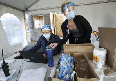 Tensions rise as virus cases surge in Wisconsin, Dakotas