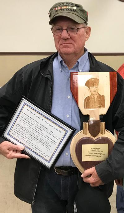 Ellison and plaque