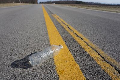 Litter on highway stock photo