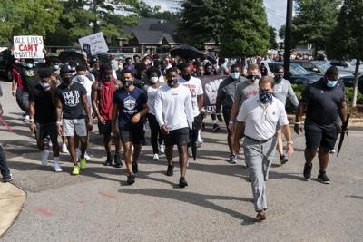 Nick Saban, Alabama players hold protest march on campus