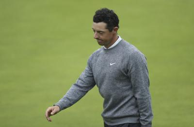 Lowry, Holmes share Open lead as McIlroy leaves with cheers