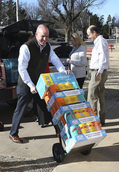 Security National Bank donates school supplies to Adams Elementary