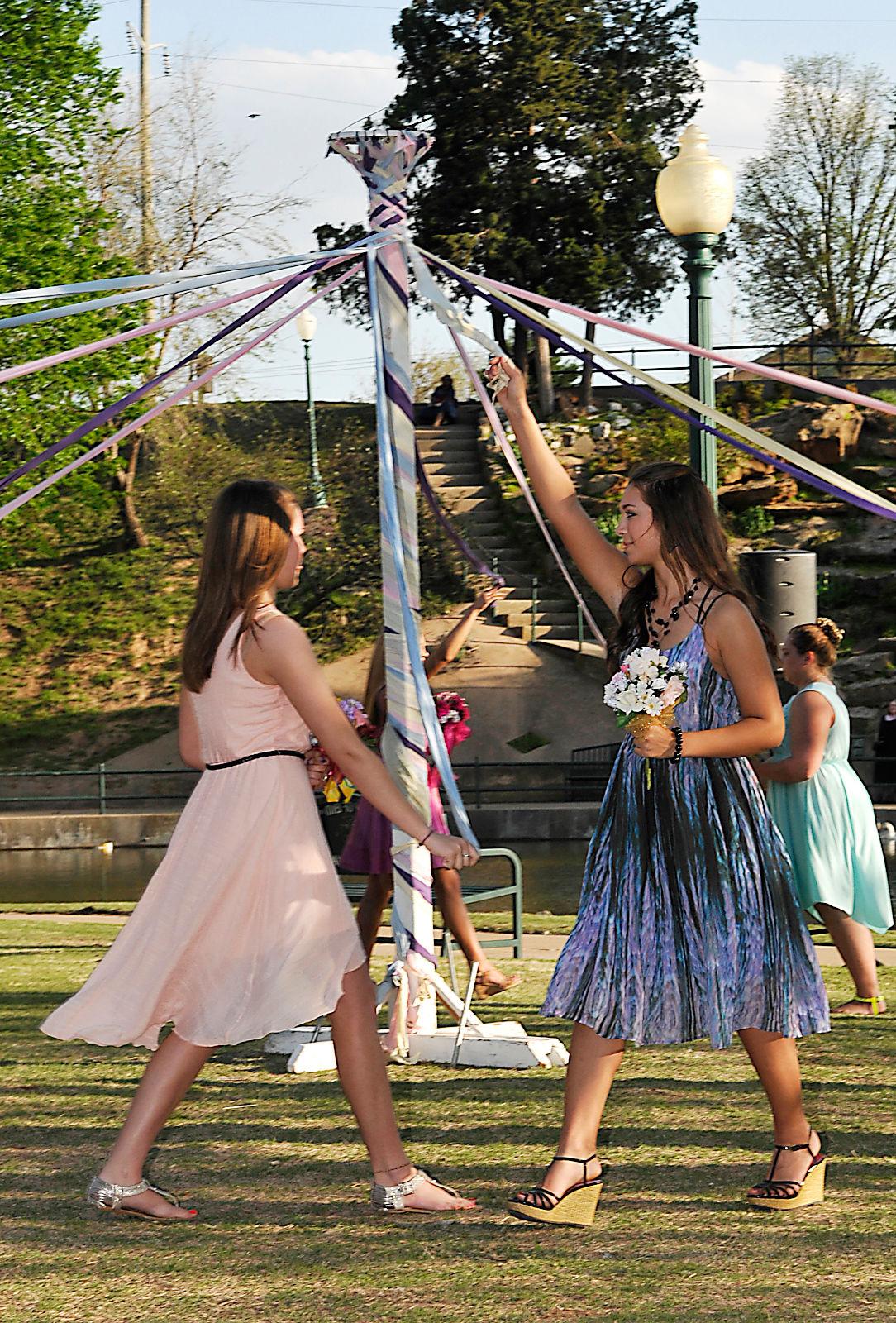 Enid High School female students wrap a