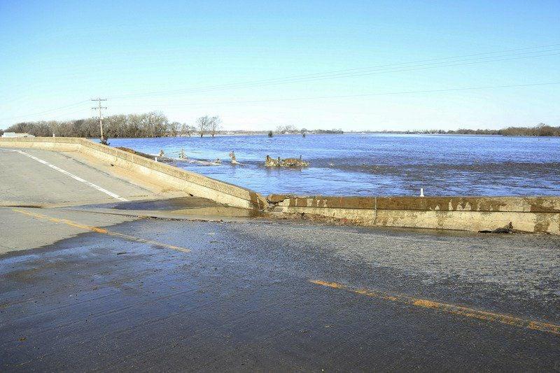AP: States brace for long-term flood fight as damages mount