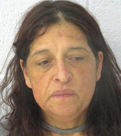 Woman arraigned in fatal home invasion