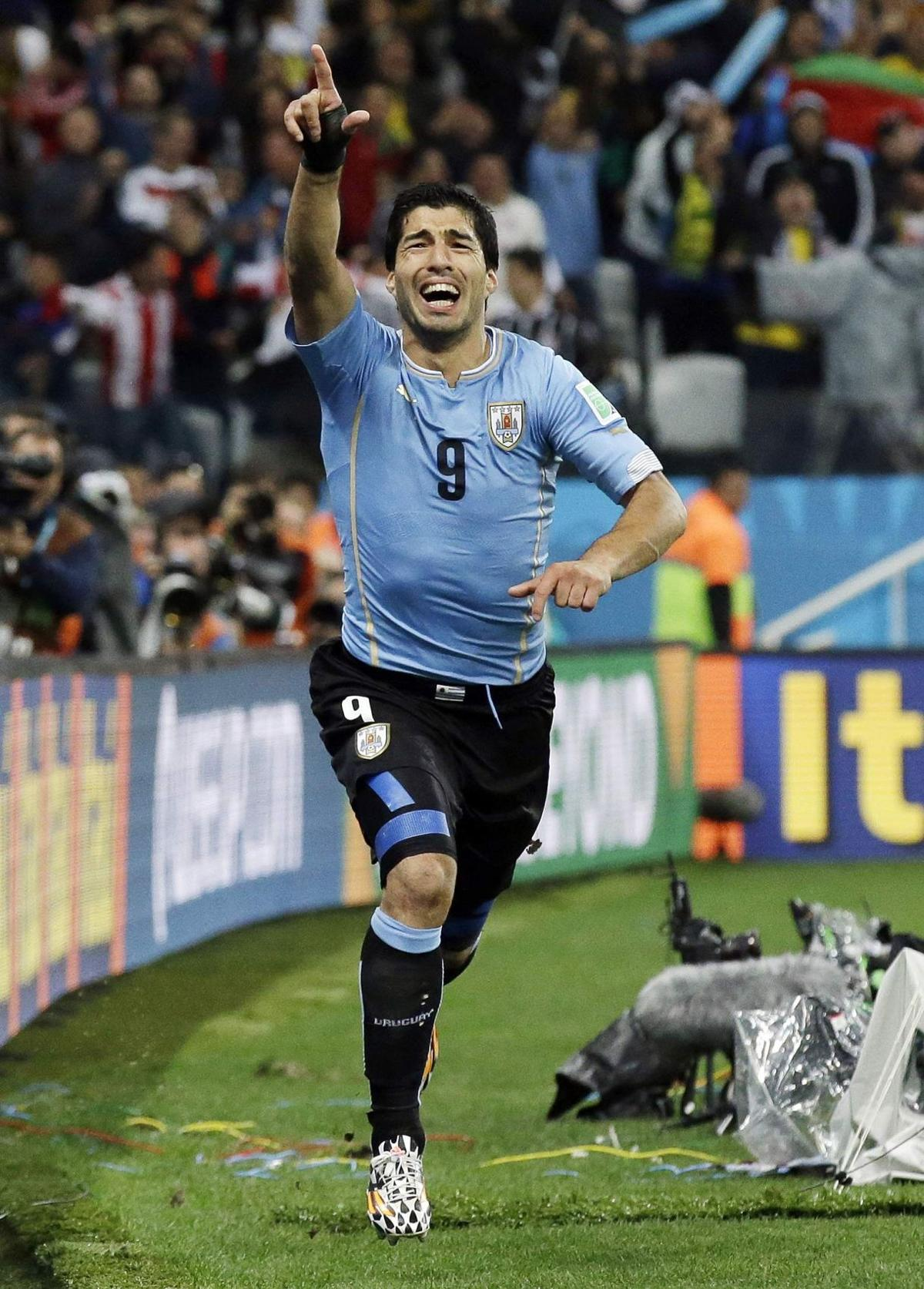 55877c38bbe Uruguay s Luis Suarez celebrates after scoring his side s second goal  during the group D World Cup soccer match between Uruguay and England at the  Itaquerao ...