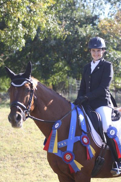 Perry girl wins top honors in equestrian dressage