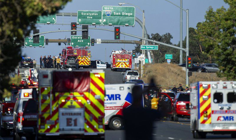 Shootout on freeway overpass leaves officer, gunman dead