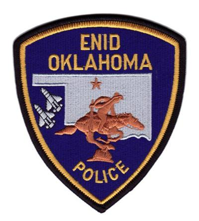 Enid man charged with failing to care for brown lab