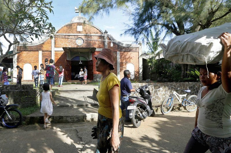 A US priest, a Philippine village, and decades of secrecy