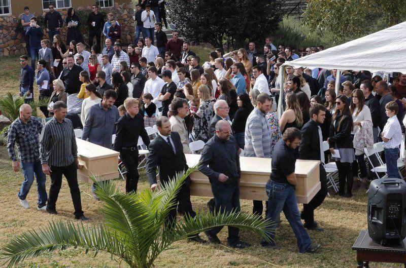 Mexico farm town buries 3 of 9 slain Americans