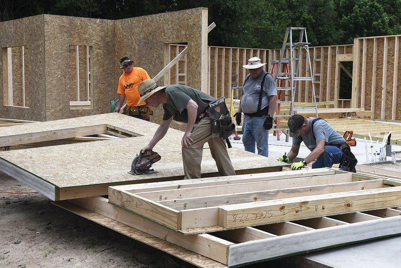 Volunteers building missionaries new home in Enid