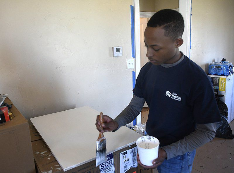 'Faith in action' — Marquette students help remodel Enid home