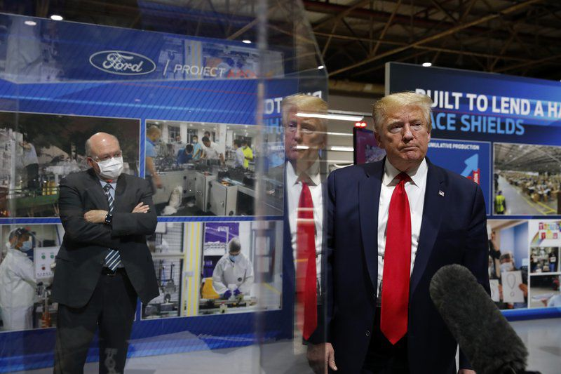 Pandemic politics: Maskless Trump tours Michigan Ford plant