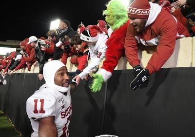 Motley closes out demons in Oklahoma's Bedlam win