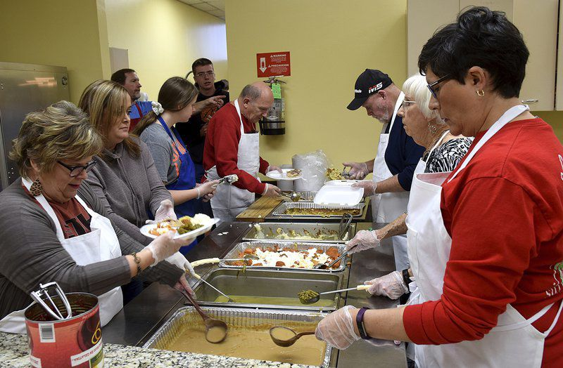 Volunteers feed those who hunger at First Baptist and St. Francis