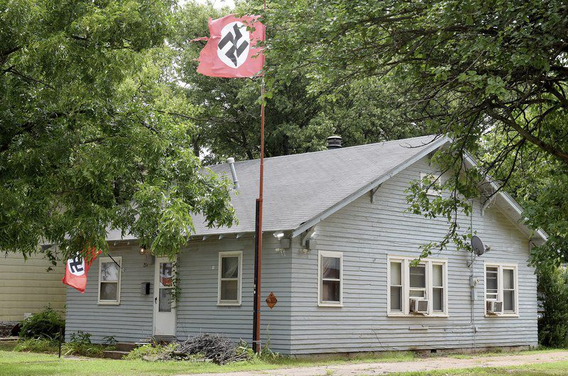 Man displaying swastikas arrested for shooting woman taking flag