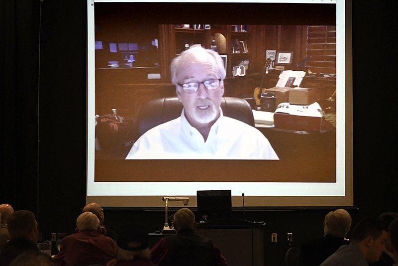 Candidate speaks in AMBUCS forum, incumbent provides video