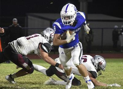 Prep roundup: Parker Smith, Wildcats whip Barnsdall 48-8
