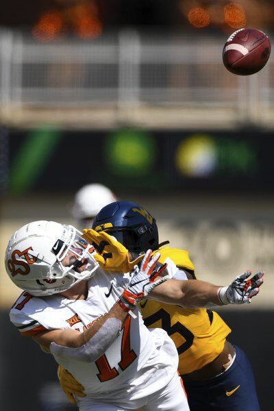 Hubbard, No. 15 Oklahoma State escape with win over WVU