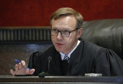 Judge orders opioid trial to continue