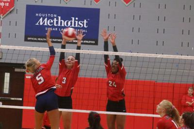 Travis outlasts Dulles in five-set battle