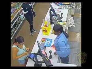 Suspects Seen on Cameras Using Card Stolen in Robbery