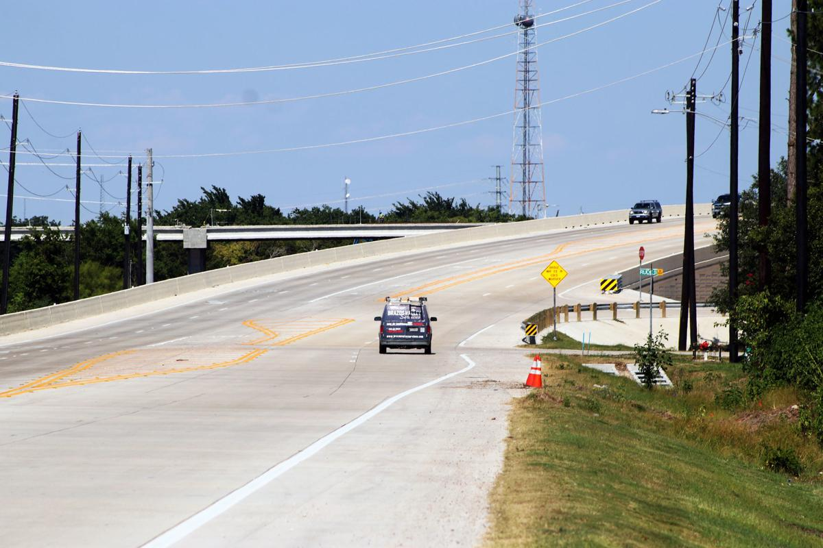 Two parts of three-way overpass now open