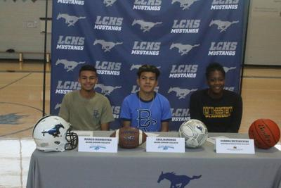 Three Mustangs sign with junior colleges