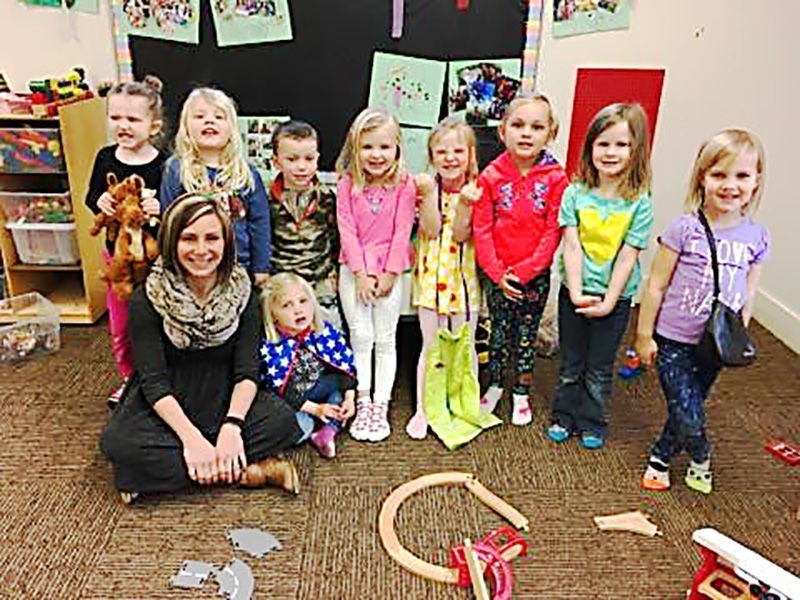 """Students showing """"happy faces"""" with therapist, Tera Oland.Provided."""