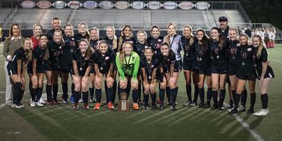 Lady Blackcats win district, advance in region tourney