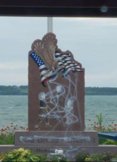 Police have 'person of interest' in memorial vandalism