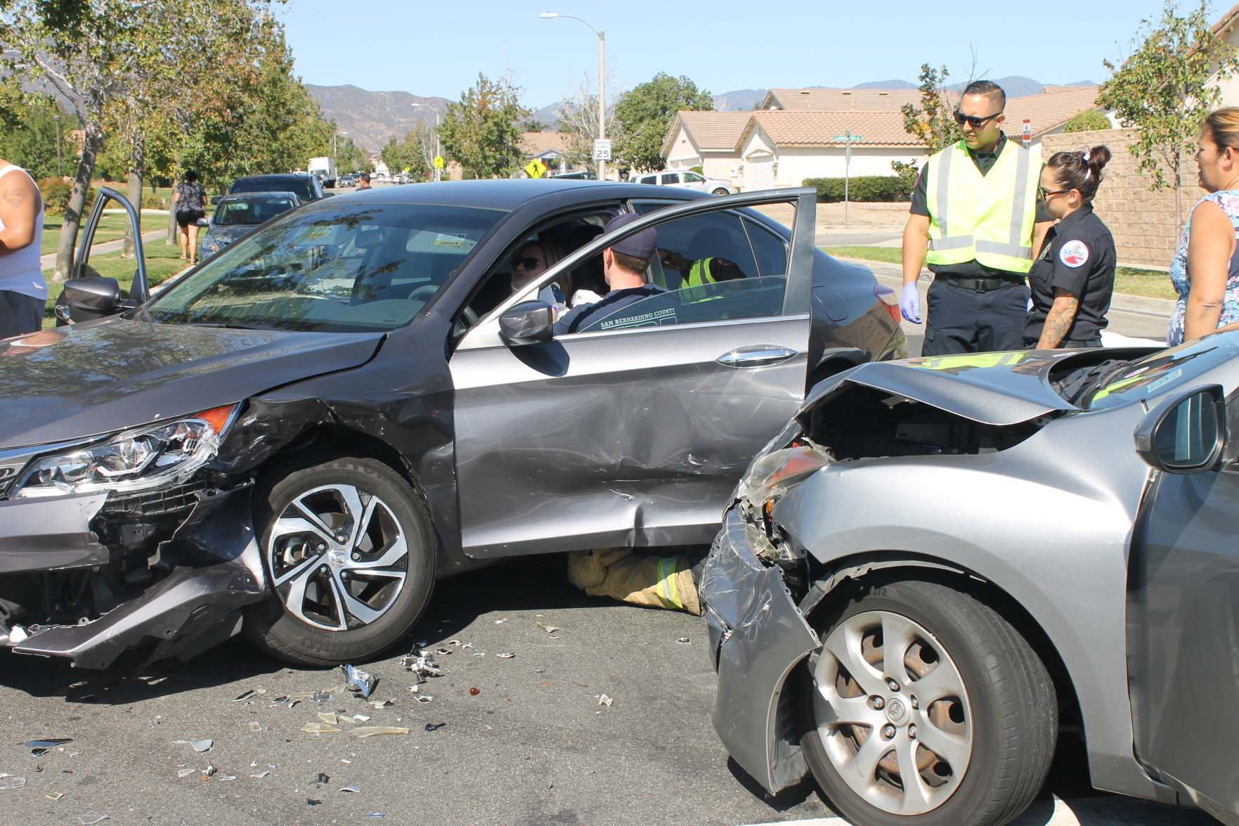 Fire Department Personnel Treat A Woman In A Honda After Her Car Was Struck  By A Mazda On The Corner Of Almeria And Baseline Avenues In Fontana On Oct.  15.