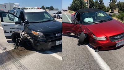 Sedan hits police car