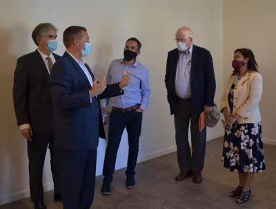Officials tour affordable housing community