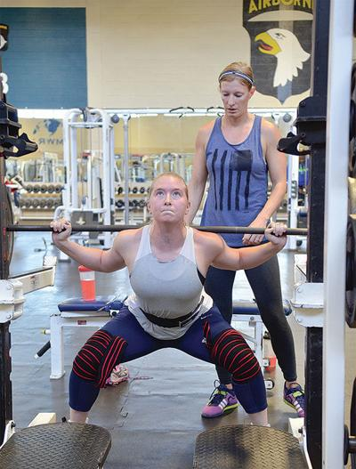 MORALE, WELFARE AND RECREATION: Soldiers vying for titles, prizes in weight lifting event at Olive PFC