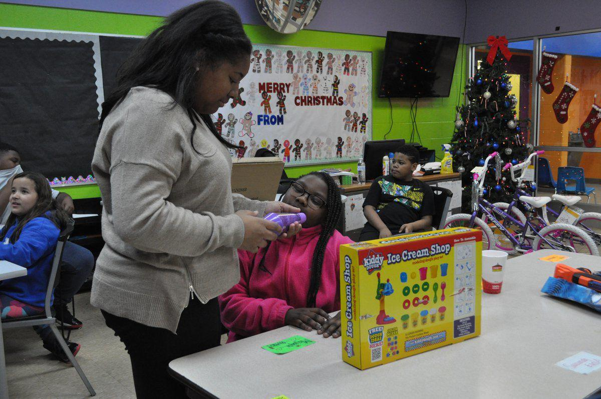 Boys and Girls Club hosts surprise holiday party for kids