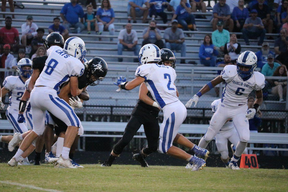 Late surge leads Wildcats to fall, 41-14