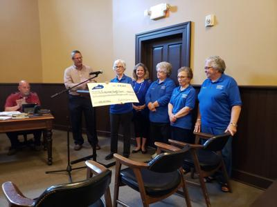 Fiscal Court receives check from Simpson County Homemakers