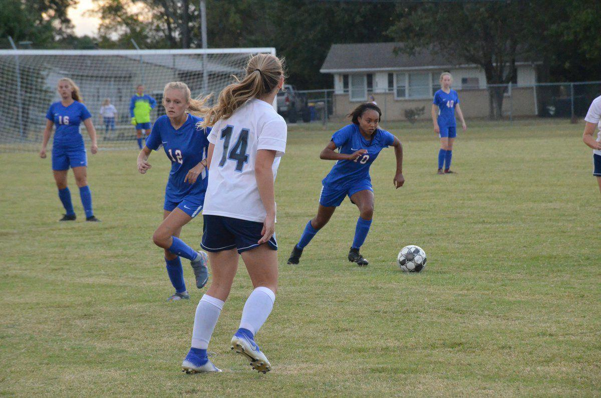 Lady Cats split final two district matches