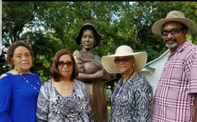 Members of the African American Heritage Center attend statue unveiling