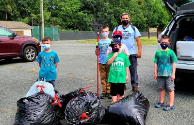 Cub Scout Pack 22 cleans up at Lee Hill Park