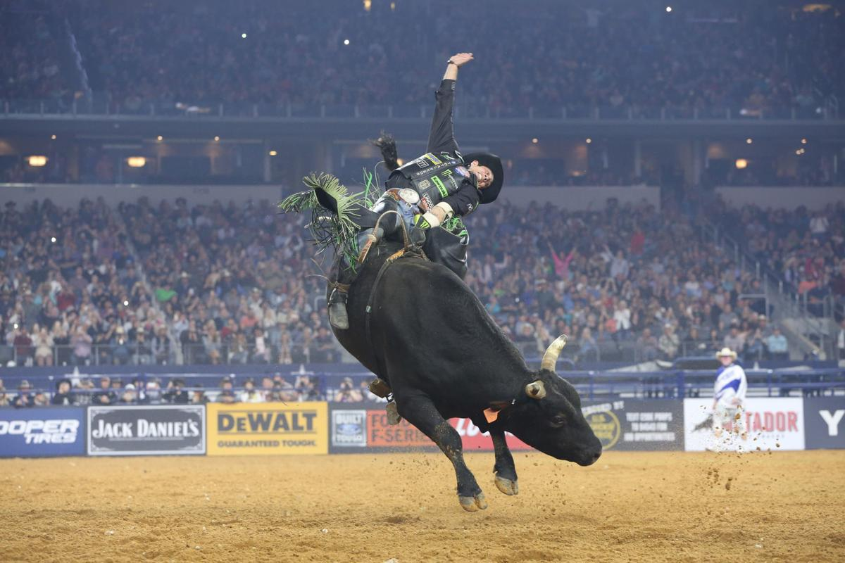 27a3e1b0e9757 JB Mauney touches the sky in the Arlington Last Cowboy Standing PBR 25th  anniversary Unleash the Beast. The tour is in Fairfax this weekend.