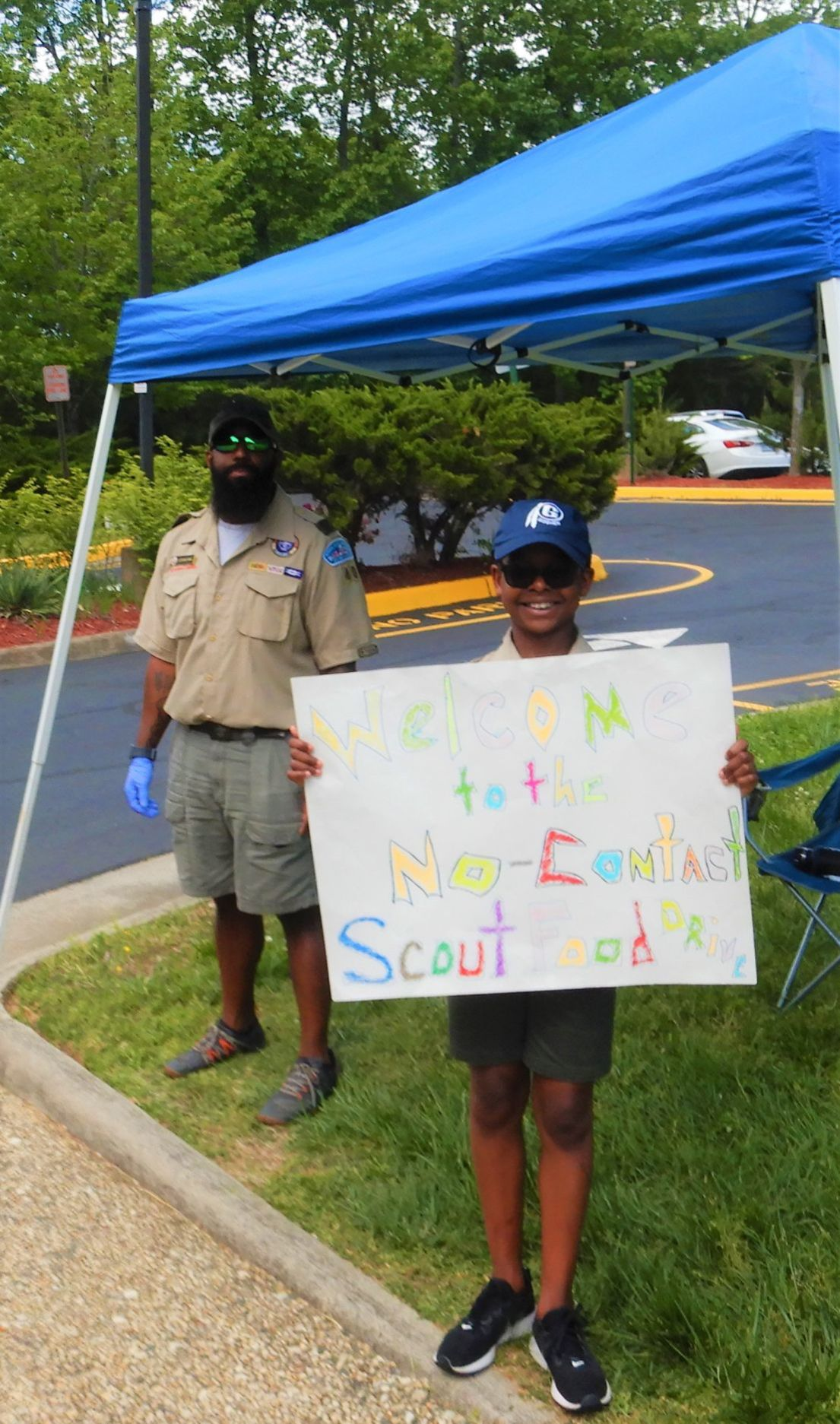Aquia District Scouts welcome donors to the no-contact food drive