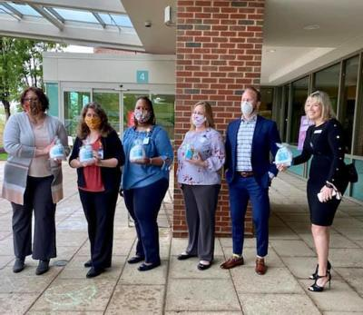 Representatives from HMP Properties deliver gift bags to Stafford Hospital staff