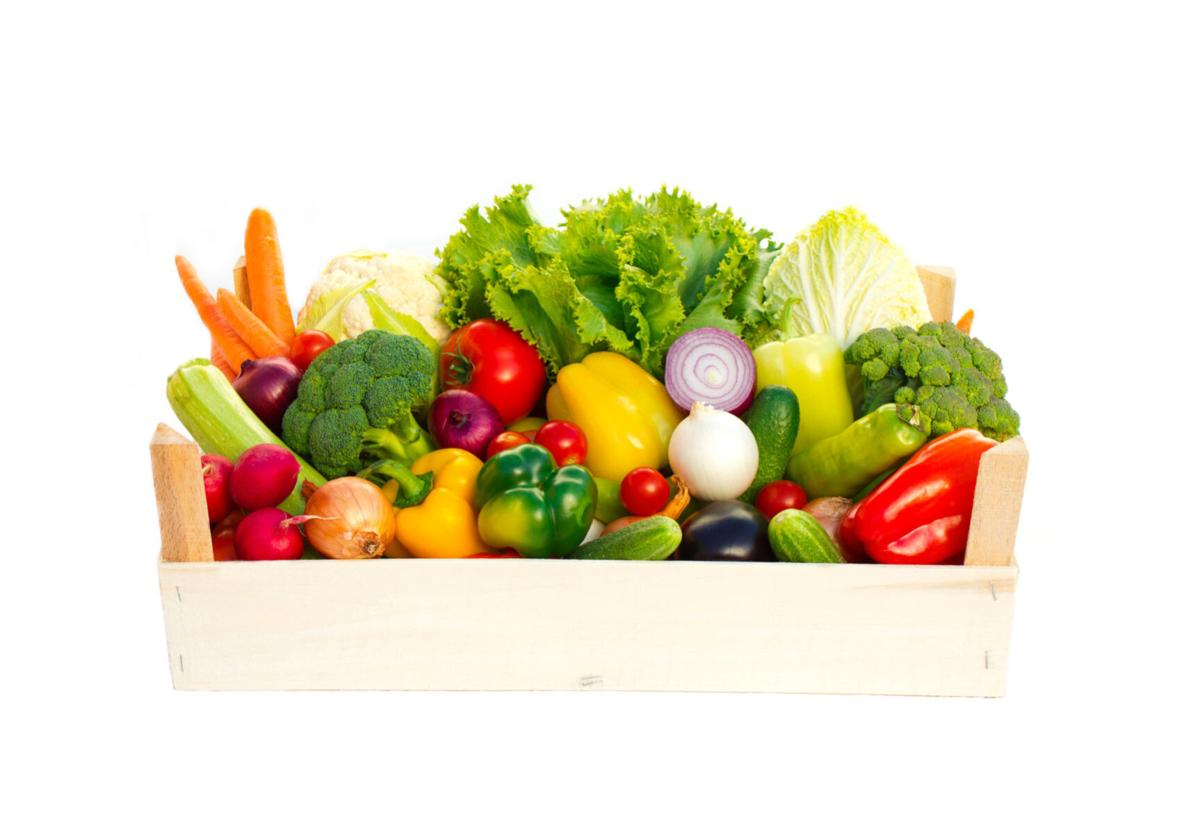 Close-up of a wooden crate filled with vegetables